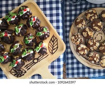 Food decoration with fresh seasonal fruits (melon, papay, lemon lime and watermelon) and Bekery ( banana cake and mini coffee eclair).
