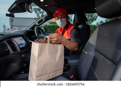 Food delivery Business, unemployed Man drive for delivery service effect from Covid-19 disceas