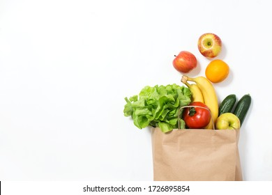 Food delivery. Craft bag with vegetables and fruits on a white background. Online order from the grocery store