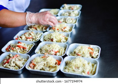 Food delivery. preparing food portions in containers. delivery service during quarantine covid-19. Chicken with vegetables and cheese. airline food. airline meals and snacks. takeaway selective focus