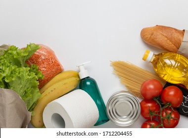 Food delivery service. Buy products online during quarantine. Healthy food and antiseptic on white background. Sunflower oil, salad,tomatos, pasta, bread, lentils, caned food, toilet paper, sanitizer.