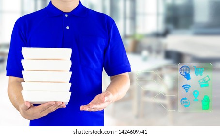 Food delivery service or order food online. Delivery man hand holding fast food packaging in blue uniform and icon symbol media on restaurant background. Business and technology for lifestyle in city.