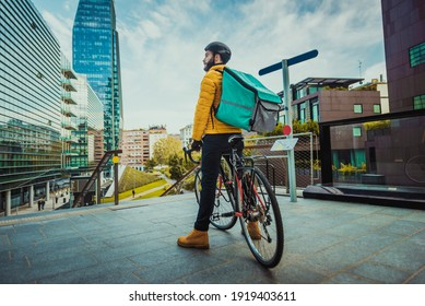 Food delivery service, rider delivering food to clients with bicycle - Concepts about transportation, food delivery and technology