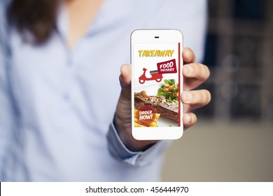 Food delivery take away app in a mobile phone screen. Phone in hand.