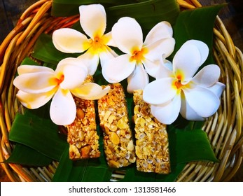 food and dessert concept. Thai sweets are arranged on banana leaves in wicker baskets. And decorated with white flowers. Selective focus and copy space.