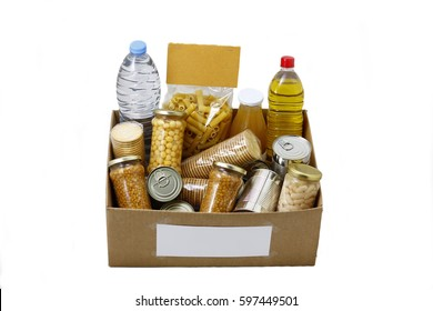 Food in a donation box for neediness and poverty charity, isolated in a white background