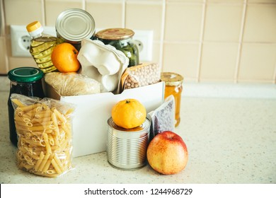 Food donations in box in kitchen background, copy space