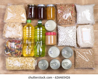 Food donations on wooden background, top view