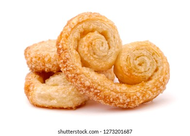 Food and drink: arranged group of puff pastry cookies, isolated on white background