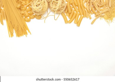 Food and drink concept - various uncooked pasta on white background. Top view.