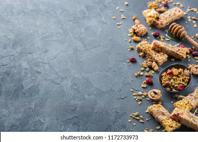 Food and drink, dieting, nutrition breakfast concept. Healthy homemade cereal granola muesli bars with oats, nuts, dry berries on a cozy kitchen table. Copy space background