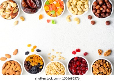 Food and drink, dieting, nutrition breakfast concept. Ingredients for granola homemade gluten free bars on white stone background. Top view, copy space.