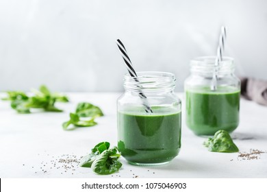 Food and drink, dieting and nutrition concept. Healthy green vegan smoothie with spinach leaves, spirulina and chia seeds for detox in summer days