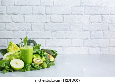 Food and drink, healthy dieting and nutrition, lifestyle, vegan, alkaline, vegetarian concept. Green smoothie with organic ingredients, vegetables on a modern kitchen table. Copy space background