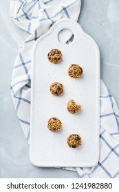 Food and drink, healthy lifestyle, eating, diet and nutrition, snack, superfood concept. Handmade raw vegan protein energy balls with sesame seeds, dry cranberry, nuts, honey