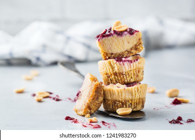 Food and drink, healthy lifestyle, eating, diet and nutrition, snack, superfood concept. Handmade no bake raw vegan protein energy peanut butter bars or cheesecakes on a kitchen table