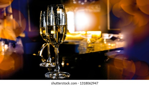 Food and drink, holidays party concept. Champagne sparkling in a glass on the bar .