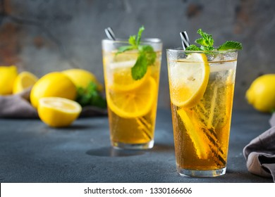 Food and drink, holidays party concept. Lemon mint iced tea cocktail refreshing drink beverage in a glass on a table for summer days