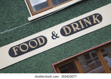 Food and Drink Sign on Diagonal Slant
