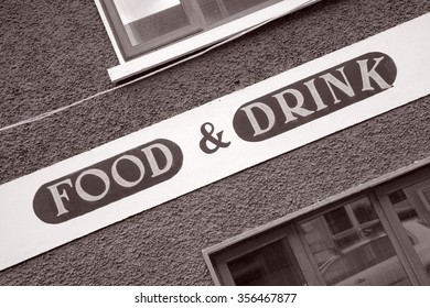 Food and Drink Sign on Diagonal Slant in Black and White Sepia Tone