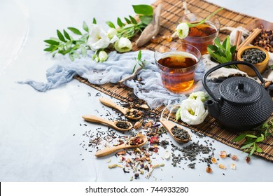 Food and drink, still life concept. Selection assortment of different japanese chinese herbal masala tea infusion beverage teapot with white flowers on the table