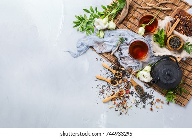 Food and drink, still life concept. Selection assortment of different japanese chinese herbal masala tea infusion beverage teapot with white flowers on the table. Top view, copy space background