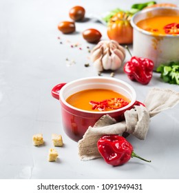 Food and drink, still life, diet and nutrition concept. Seasonal red tomato pepper soup gazpacho with ingredients on a kitchen table