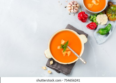 Food and drink, still life, diet and nutrition concept. Seasonal red tomato pepper soup gazpacho with ingredients on a table. Top view flat lay, copy space background