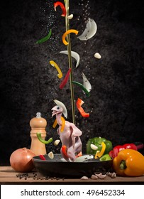 """food falling, food flying """"Stir Fried quail, partridge with Black Pepper"""" Concept Humor, joke and creativity cooking."""