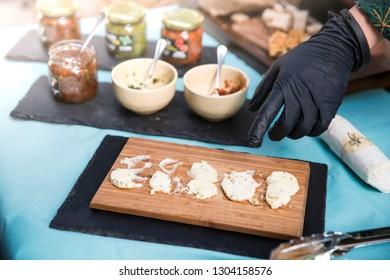 Food festival cheese and pesto made of garlic, basil, tomato, oil, fungi