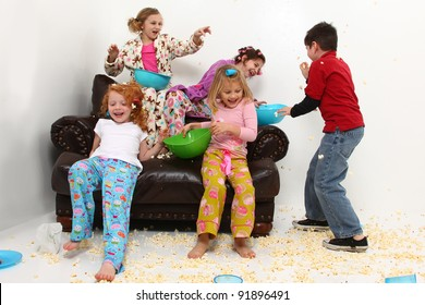 Food fight with brother at girl's pajama party sleep over with popcorn mess.