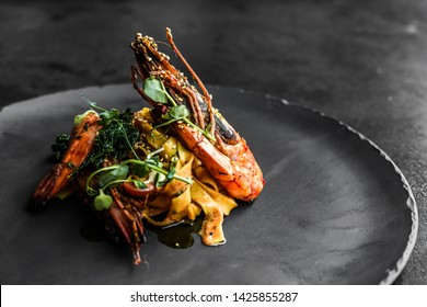 food fish elegant gourmet black plate top view lunch dinnerdish meal fine dining closeup green sea seafood shrimp beautiful modern - Shutterstock ID 1425855287