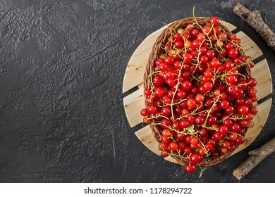 Food flatlay items. Red currant berries lying on gray concrete background. Top view with copy space