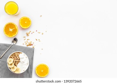 food for healthy breakfast with granola and fresh orange juice on bright white background top view mock up