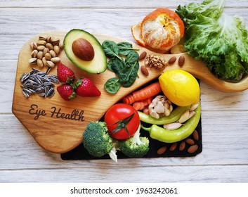 Food for healthy eyes and good eyesight. Natural products to boost eye health and improve eyesight. Assortment of food for good vision. Fresh fruit and vegetable rich in antioxidant, lutein zeaxanthin