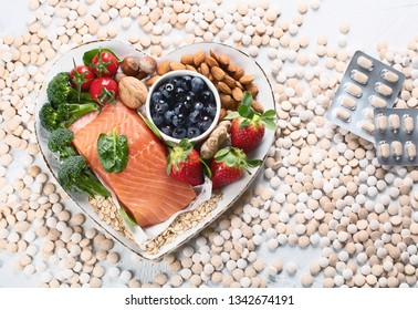 Food for healthy heart and pills. Top view