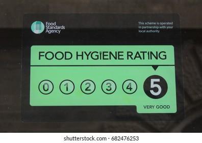 FOOD HYGIENE RATING 5 - a sign on a window in Pike street in Liskeard, Cornwall
