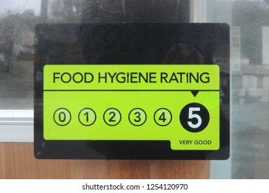 A Food Hygiene Rating sign showing a rating of 5, on a cafe in Polperro, Cornwall