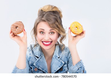 Food Ideas and Concepts. Young Caucasian Blond Girl Playing With Doughnut in Hands. Posing Against White.Horizontal Image Composition