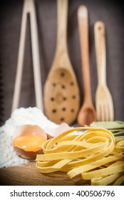 Food image shot, italian Pasta, different pastas on the table with flour and eggs
