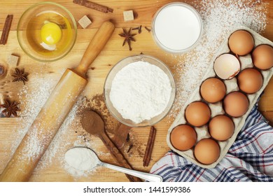 Food ingredients for baking: flour, eggs, milk, sugar