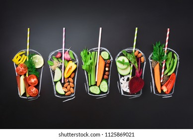 Food ingredients for blending smoothie or juice on painted glass over black chalkboard. Top view with copy space. Organic vegetables, nuts, seeds. Vegetarian, vegan, detox, clean eating concept.
