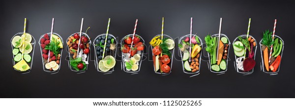 Food ingredients for blending smoothie or juice on painted glass over black chalkboard. Top view with copy space. Organic fruits, vegetables, nuts, seeds. Vegan, detox, clean eating concept.