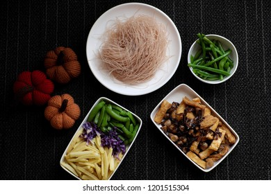 Food ingredients for dry rice vermicelli fried with vegetables from top view, Vietnamese vegetarian dish for vegans, a dish can make quick for breakfast at home from noodle, vegetable, mushroom, tofu
