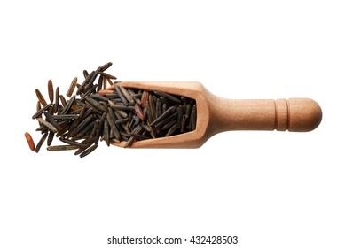 Food ingredients: heap of black rice in a wooden scoop, on white background