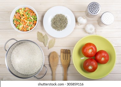 Food ingredients and kitchen utensils for cooking on wooden background, top view