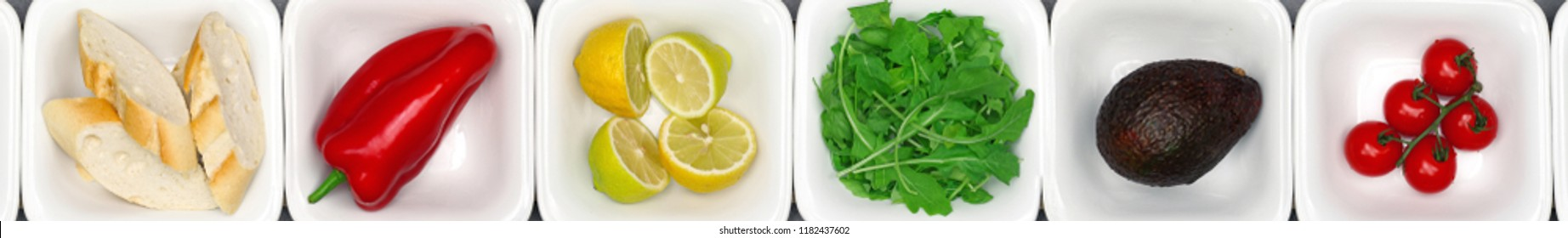 Food ingredients prepared for cooking in white bowls.