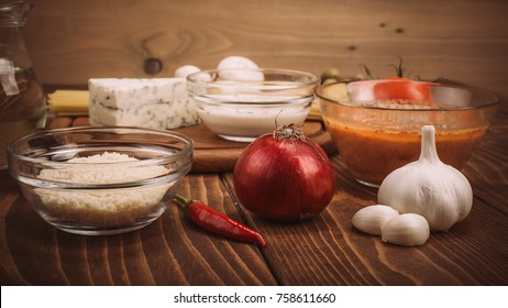 Food ingredients for preparing pasta on rustic kitchen table. Close up