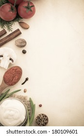 food ingredients and spices on aged background