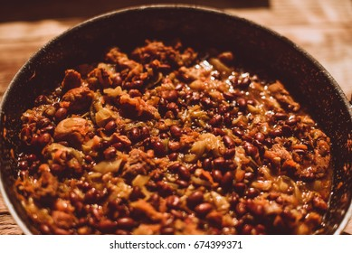 Food ingridients: red beans, carrot, cabbage, meat, onion, ginger for recipe stewed beans with meat on wooden background. Steps in cooking, process of preparing food. Concept of homemade healthy food.